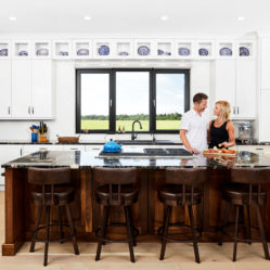 couple in kitchen with charcuterie tilt and turn residential windows