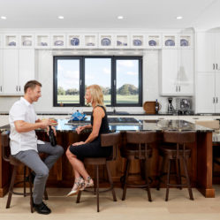 couple in kitchen with wine tilt and turn residential windows