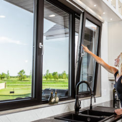 tilt and turn window with woman opening residential