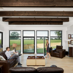 large tilt and turn windows with transoms and couple lounging in living room