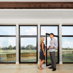 large tilt and turn windows with transoms and couple having wine