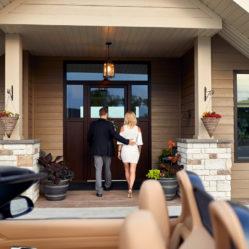 Porche convertible tilt and turn windows exterior door residential with couple walking to door