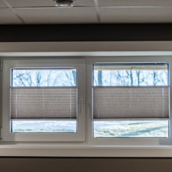 lower level residential tilt and turn windows with custom blinds