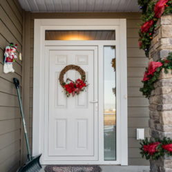 exterior residential white door with Christmas decorations