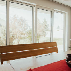 tilt and turn windows in dining room with bench