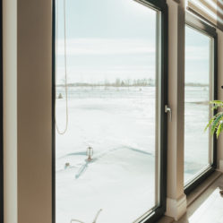 large residential living room tilt and turn windows with winter scene in background